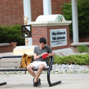 Student Studying Outside Gamble Hall